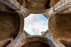 Inside architecture ceiling with opening. Arches of an ancient medieval church ruin with blue sky in Visby Gotland Sweden. Historical ruins with free entry.