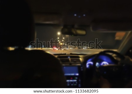 Inside atmosphere of moving car blur background.Accident cause by very fast speed moving car driving at night.