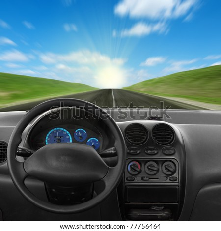 Inside car view at high speed. and sky