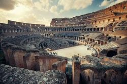 Inside Colosseum view at sunset, the world known landmark and the symbol of Rome, Italy.