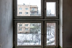 Inside corridor in old Soviet apartment building in Rivne, Ukraine in winter with nobody in run-down closed window interior of floor