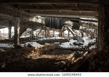 Inside devastated and abandoned industrial building