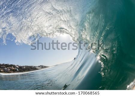 Inside Hollow Ocean Wave Clean Ocean Wave Surging And Crashing Towards Shallow Sandbars And Shoreline
