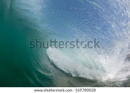 Inside Hollow Wave Water swim view looking inside hollow curling crashing blue wave #169780028
