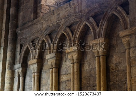 Inside interior Durham Cathedral, England. Church of Christ, Blessed Mary the Virgin and St Cuthbert's of Durham. Gothic architecture, religious spooky background. Religious architecture concept  #1520673437