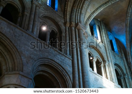 Inside interior Durham Cathedral, England. Church of Christ, Blessed Mary the Virgin and St Cuthbert's of Durham. Gothic architecture, religious spooky background. Religious architecture concept  #1520673443