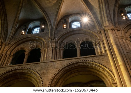 Inside interior Durham Cathedral, England. Church of Christ, Blessed Mary the Virgin and St Cuthbert's of Durham. Gothic architecture, religious spooky background. Religious architecture concept  #1520673446