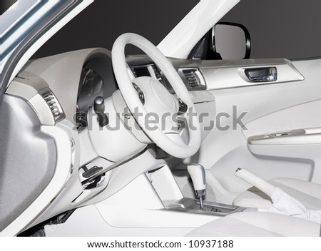 Inside look at a white leather new car interior. Very clean sleek lines and elegant design. - stock photo