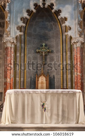 Inside of a church showing the altar. The church is Church of the Incarnation Roman Catholic Church in New York.