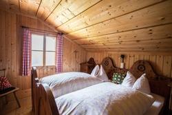 Inside of a rustic wooden alpine hut or cabin, Austria