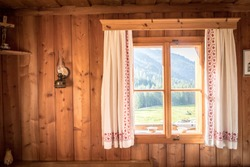 Inside of a rustic wooden hut or cabin, Austria