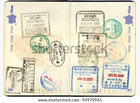Inside of a well traveled european passport with all kinds of stamps from different customs: taipei, china, thailand, hong kong, america
