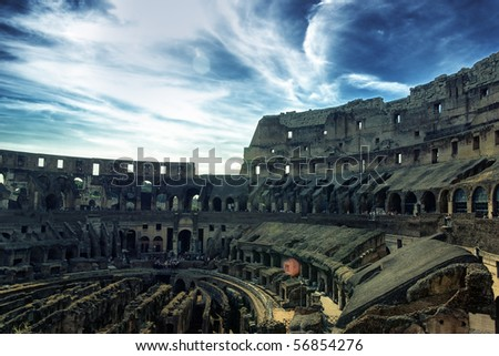 Inside of Colosseum and dramatic sky hdr