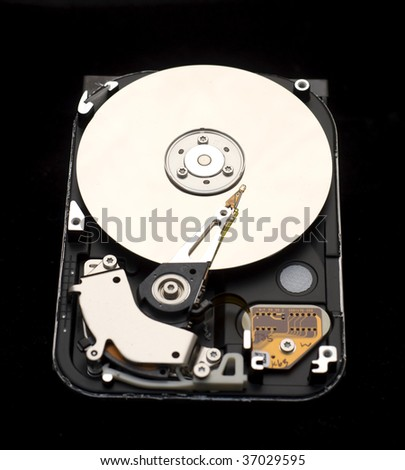 Inside of computer hard drive isolated on black - stock photo