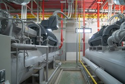 Inside of Industry factory. Chiller tower or cooling tower in building. System work machine. Condenser Water Supply and return pipe lines. Ventilation compressor. Water system in workshop.