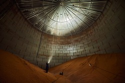 Inside of metal elevator (grain silo) in agriculture zone. Grain Warehouse or depository is an important part of harvesting. Сorn, wheat and other crops are stored in it