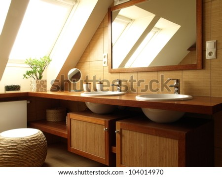 Inside of moder bathroom: top and mirror