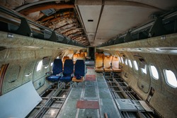 Inside of old abandoned passenger airplane. Plane wreck.