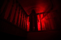 Inside of old creepy abandoned mansion. Silhouette of horror ghost standing on castle stairs to the basement. Horror Halloween concept