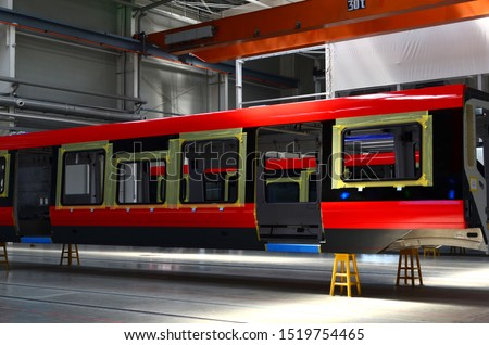 Inside of the rail car assembly plant. Industrial workshop for the production of European high speed trains. Factory of the manufacturing trainsets passenger rolling stock. Paint shop