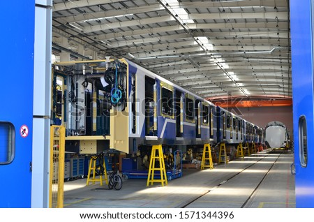 Inside of the rail car assembly plant. Industrial workshop for the production of European high speed trains. Factory of the manufacturing trainsets rolling stock for subway - Image ストックフォト ©