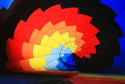 Inside part of a hot air balloon forming a multi-colored conch shell