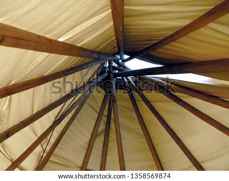 Inside Poles of a Teepee Tent Canvas #1358569874