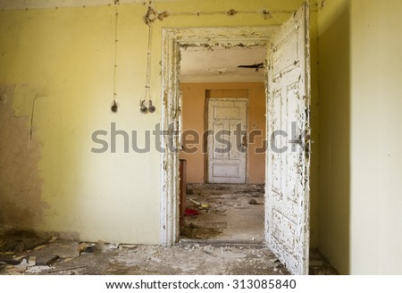 inside ruin, abandoned house with door and window in mess