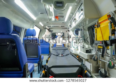 Inside smart ambulance car with medical equipment and smart robot assistant for helping patients before bring to hospital, smart medical 4.0 and smart technology for rescue human #1278565027