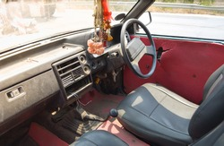 inside THAILAND old car. dried garland in old pick up car. mazda car.