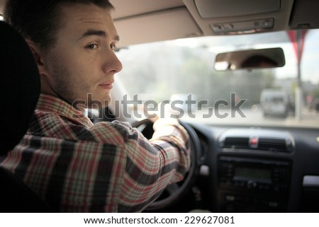 inside the car driver driving on the road