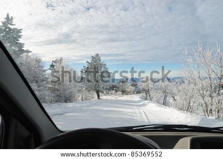 inside the car on snowy road