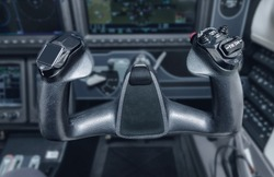 Inside the cockpit of the snall airplane. The steering wheel of the aircraft. Close up steering wheel