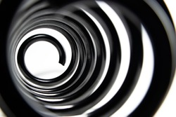 Inside the coiled metal springs on white.