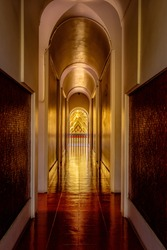 Inside the corridors of the Buddhist temple Loha Prasat in Bangkok in bright sunlight. Interior shot.