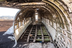 Inside the DC-3 plane wreck in Iceland at morning time