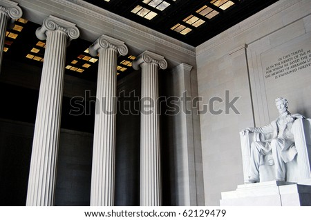 Inside the Lincoln Memorial, showing great columns and the statue of Abraham Lincoln, in Washington DC.