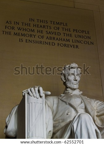 Inside the Lincoln Memorial with engraving behind Lincoln.