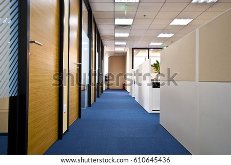 wide angle view busy design office. light enters the office corridor 610645436 detail wide angle view of busy design c
