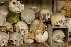Inside the ossuary of Marville, France, with thousands of ancient skulls of 19th century and older