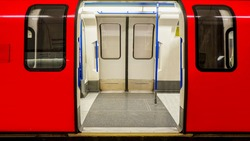 Inside view of London Underground, Tube Station, train stopped opening the door