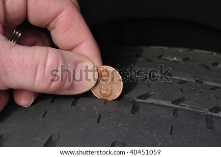 Inspecting The Wear Of A Balding Tire Tread Using a Penny