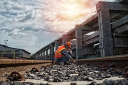 Inspector (Engineer) checking railway construction work on sky train viaduct. Which railway consist of rail track and conductor rail or third rail.construction, engineer, site,management, safety,civil
