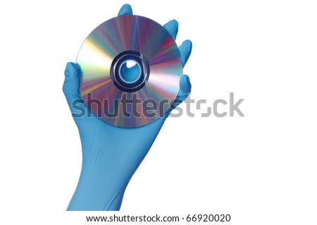 inspector in blue gloves holds in a hand confidential audio and video about hacker programs and viruses