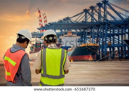 Inspector or audit checking the Cargo ship port in the harbor at sunset time