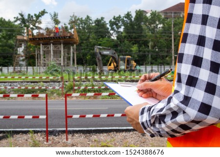 Inspectors or engineers are examining the construction of public roads in communities.