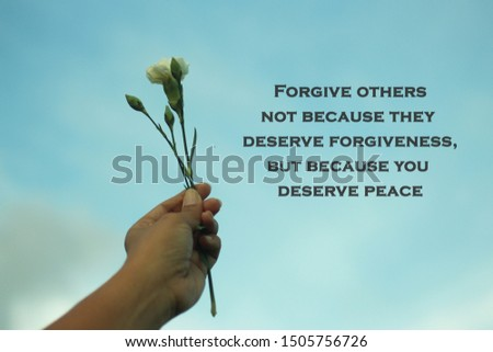 Inspiraitonal motivational quote-Forgive others not because they deserve forgiveness, but because you deserve peace. With young plant in hand on blue sky background. Stock photo ©