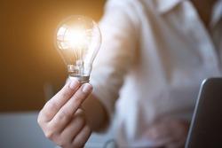 Inspiration. hand hold light bulb for good idea. brainstorming creative idea.