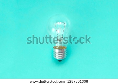 Inspiration, Idea, Motivation, Discovery, Breakthrough concept. Incandescent bulb on green background.