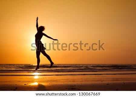 inspiration, silhouette of happy woman jumping on the beach, healthy lifestyle